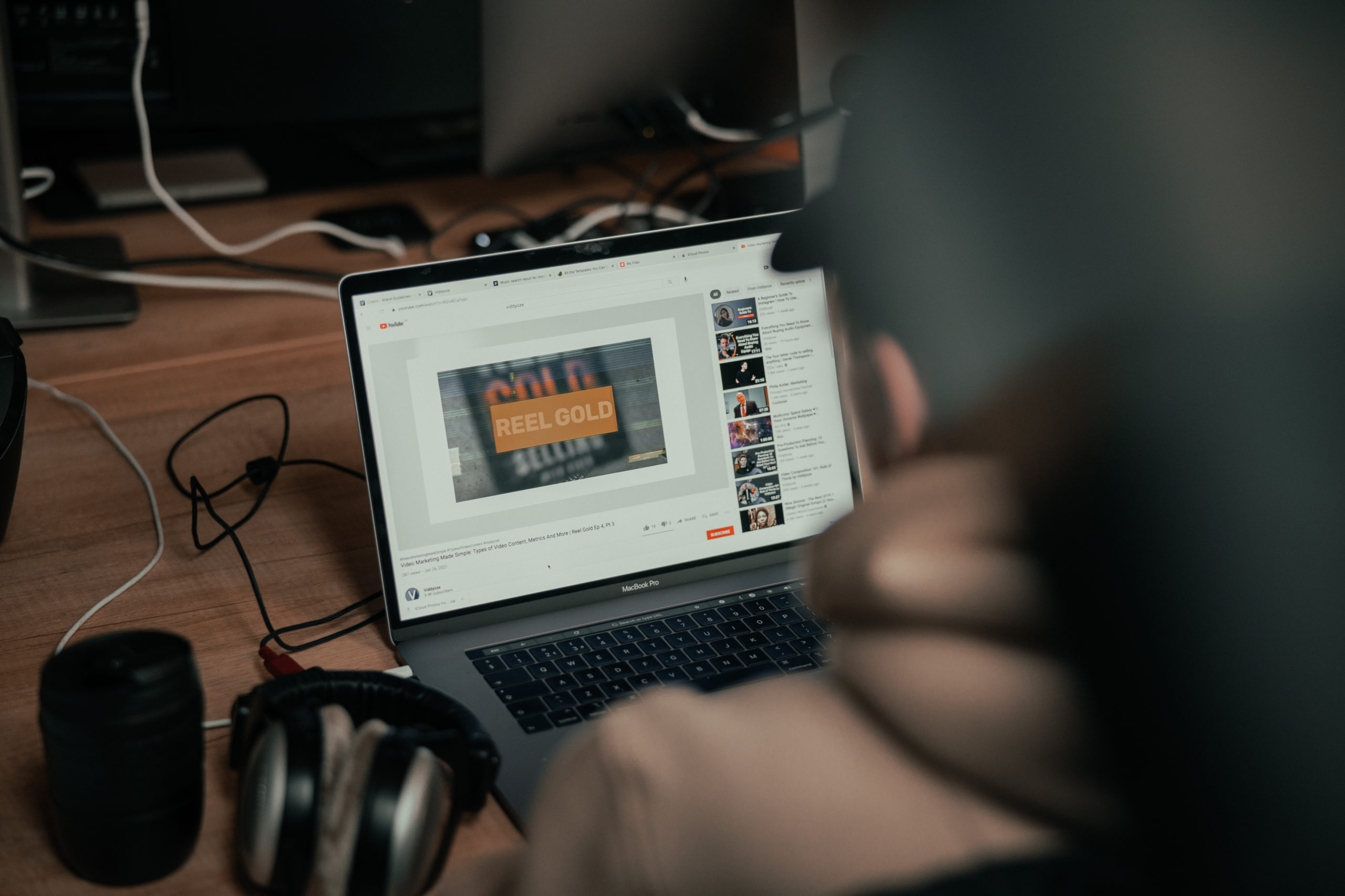 Man watching YouTube on laptop to illustrate ideas in an article called The Digital High Street