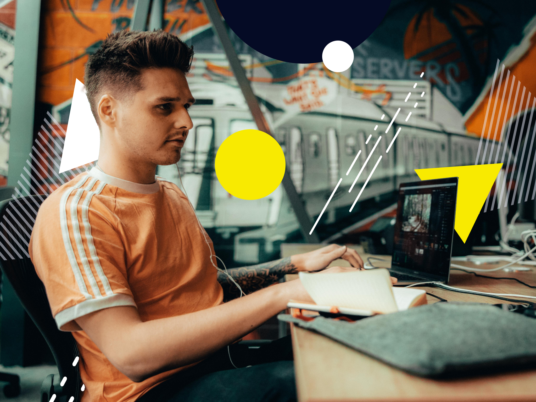 Image of a young man working at a desk looking at laptop to illustrate an article on cross-platform advertising.