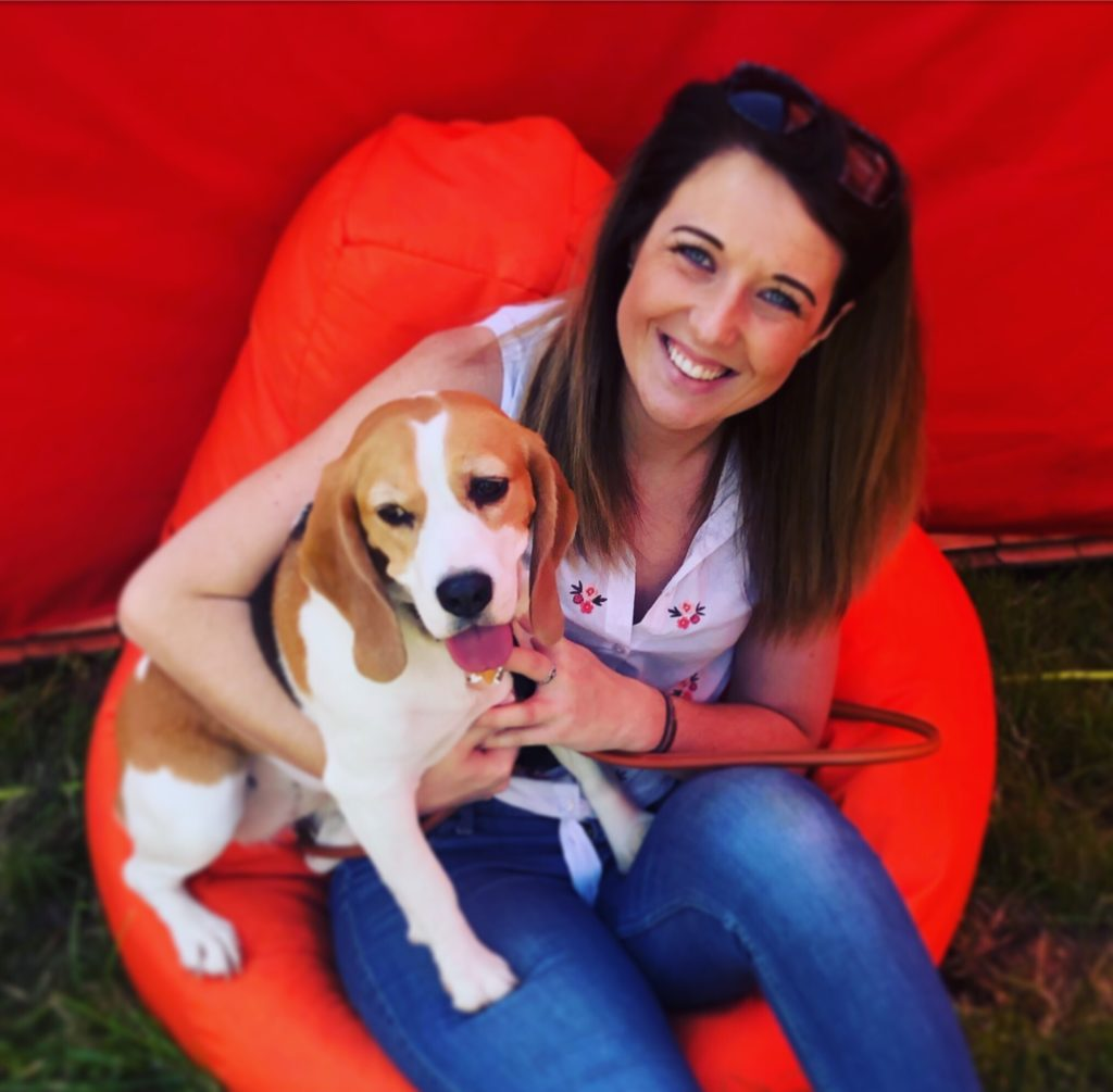 Image of Katy Morris with a dog.