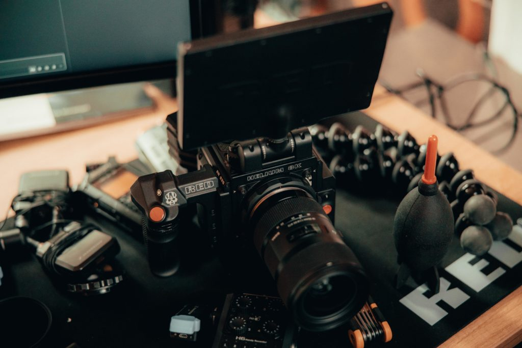 A video camera on a desk. Image is being used for an article on common video marketing mistakes.