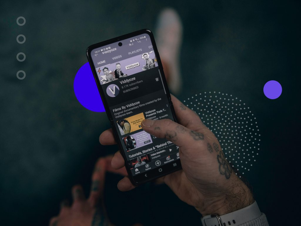 Manholding smartphone. Image being used for an article on the do's and don'ts of using music in your YouTube Videos.