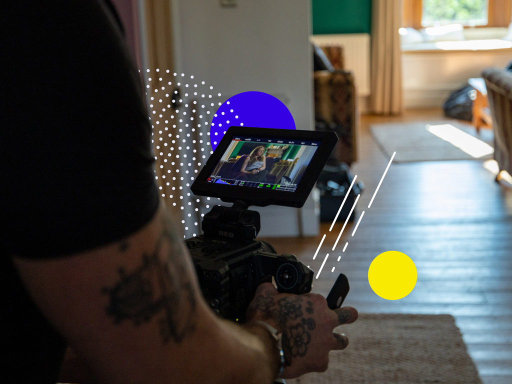 A man holding a camera. Image used to illustrate on article on hassle-free production