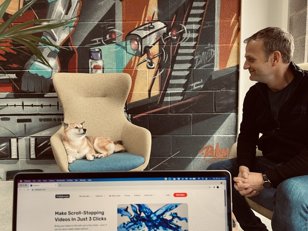 Man looking at a dog on chair –image being used to support an article on a webinar special