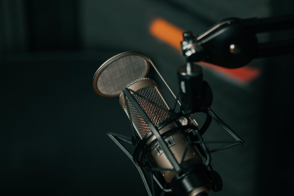 Close up shot of a microphone being used during a podcast recording